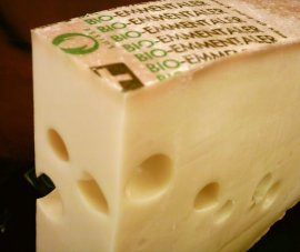 """Emmentaler"". Licensed under CC BY-SA 3.0 via Wikimedia Commons - https://commons.wikimedia.org/wiki/File:Emmentaler.jpg#/media/File:Emmentaler.jpg"